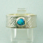 Mobile Preview: Massiver Opalring aus Gold und Silber, 0,50 ct Black Opal, Bild1